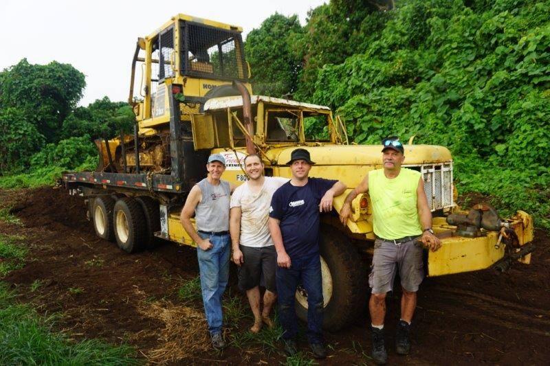 Vanuatu team moving dozer